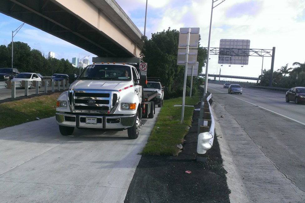 Road Ranger Flat Bed truck stands by along I-95
